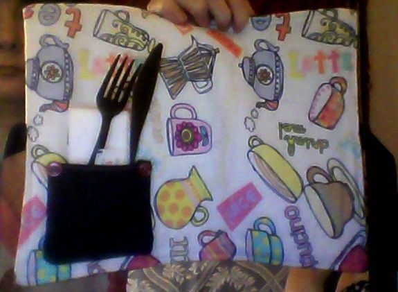 "My ""Untied For Lunch Place Mat"" - folds and ties neatly for easy storage and features a pocket for silverware & napkin(s)."