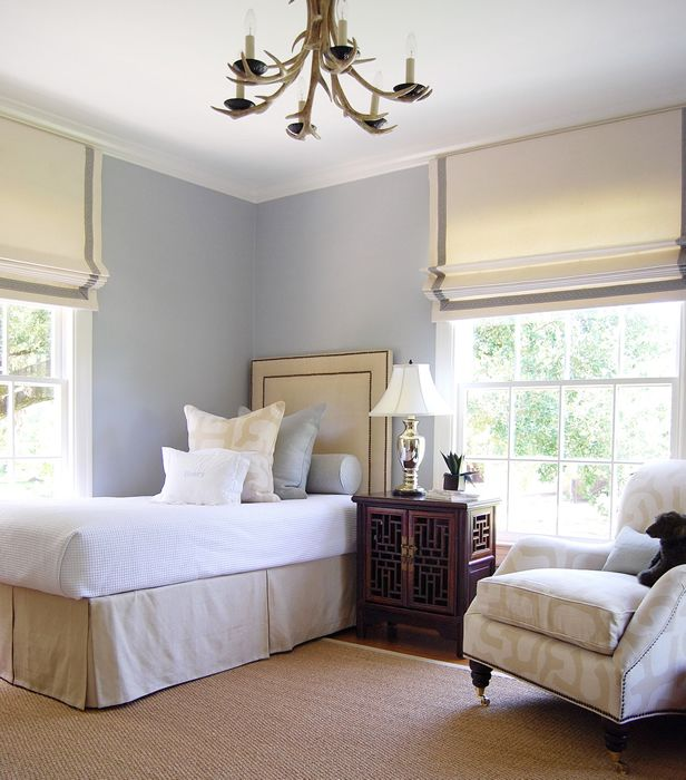 Light Blue Neutral Bedroom With Twin Upholstered Headboard Shades With Ribbon Border Antler Chandelier By Ashley Goforth Home Home Bedroom Bedroom Design