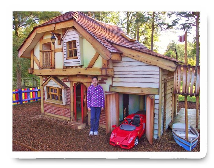 Playhouses for girls playhouse with a garage and boat for Wooden wendy house ideas