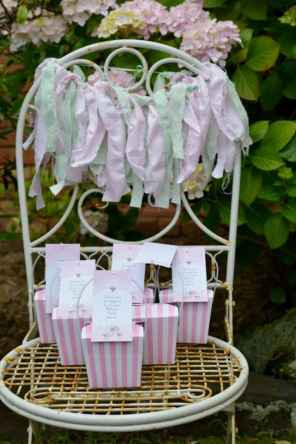 Fabric garland and party favors at a Vintage Tea Birthday Party! See more party ideas at CatchMyParty.com!