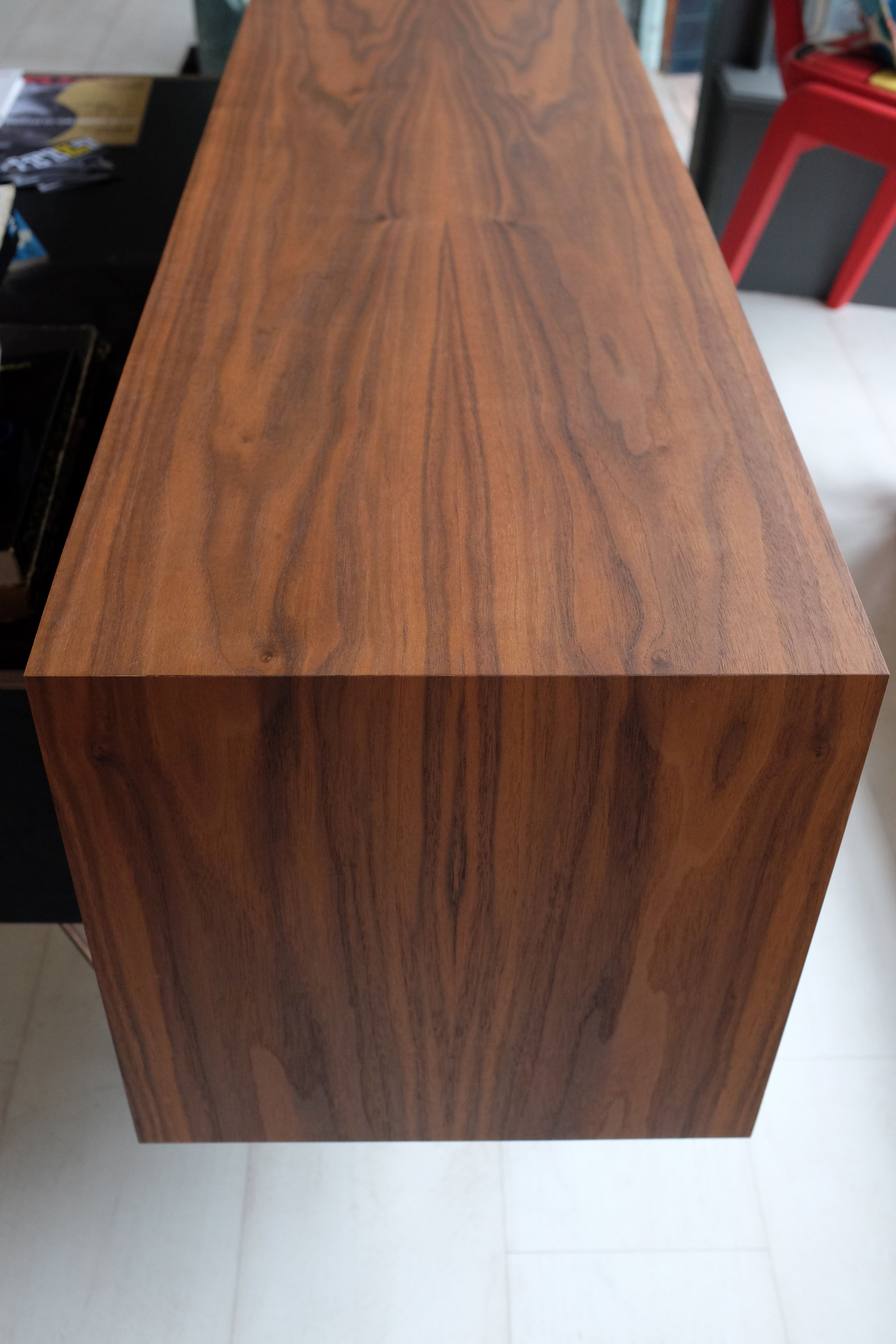 Low slung cabinet birch ply clad in bookmatched walnut