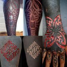 Scarification Over Blackwork Tattoos Skin Art Scarification