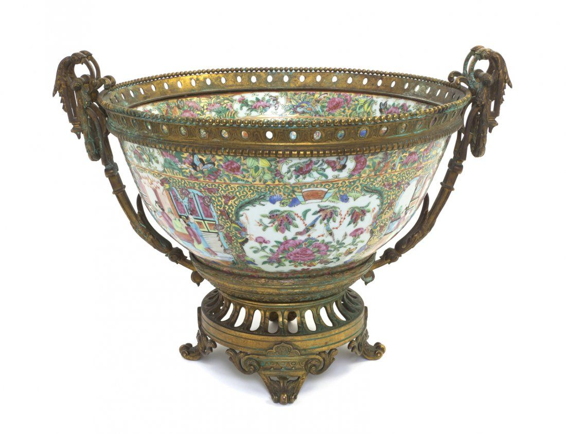 A Chinese Rose Medallion Center Bowl,  having figural cartouches surrounded by foliate decoration on a gilt reserve, with gilt metal mounts on the rim and foot.