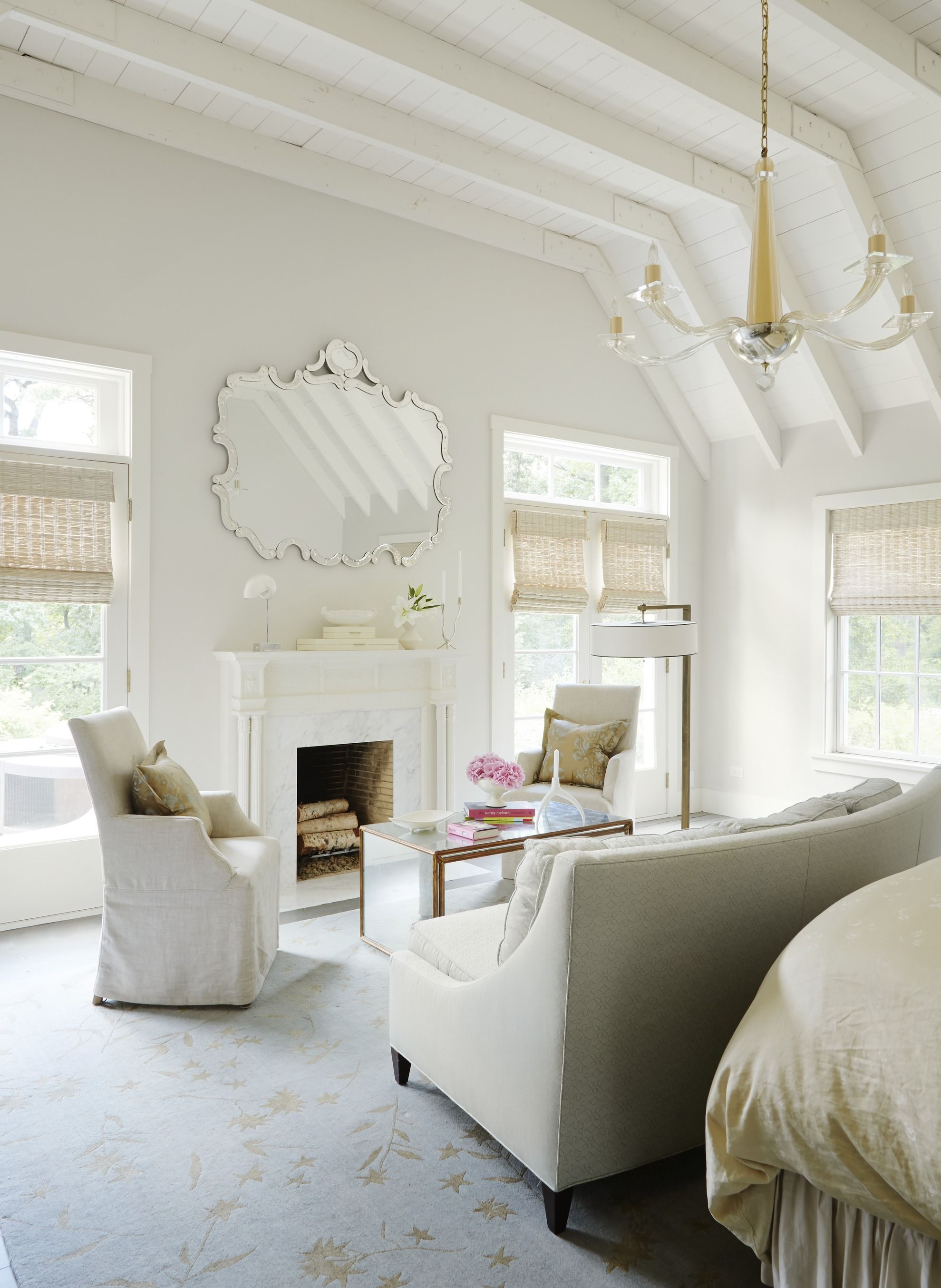Warmed by an antique fireplace surround from Belgium and glamorized ...
