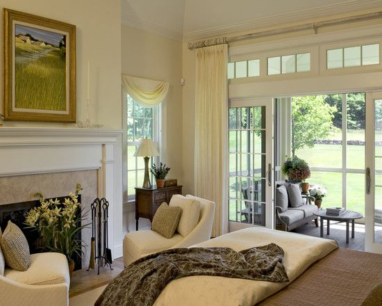 Master Bedroom With Fireplace And Gliding French Doors To Private Covered Porch