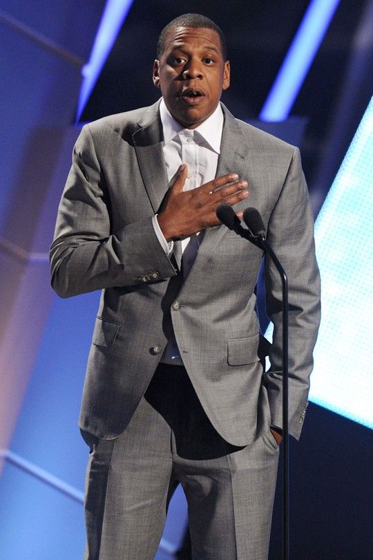 """Jay-Z  Tieless at the BET (Black Entertainment Television) Awards, where he gave Kanye a taste of his own medicine when he interrupted Yeezy's acceptance speech for Best Video for """"Otis"""".  Rex Features"""