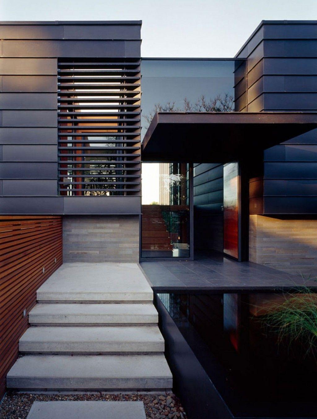 Contemporary exterior design with honed bluestone flooring and anthra zinc standing seam upper for Exterior aluminum wall cladding
