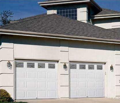 Plaza Custom Garage Doors And Windows Are No Longer The Eye Level Of A Standard Block Design Are Searc Garage Doors Residential Garage Doors Garage Door Repair