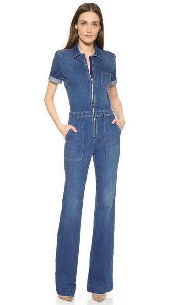 2d7b9d51a15b A retro-inspired Stella McCartney jumpsuit with a fitted bodice and flared  pants. 5 pockets. Short sleeves. Exposed front zip.