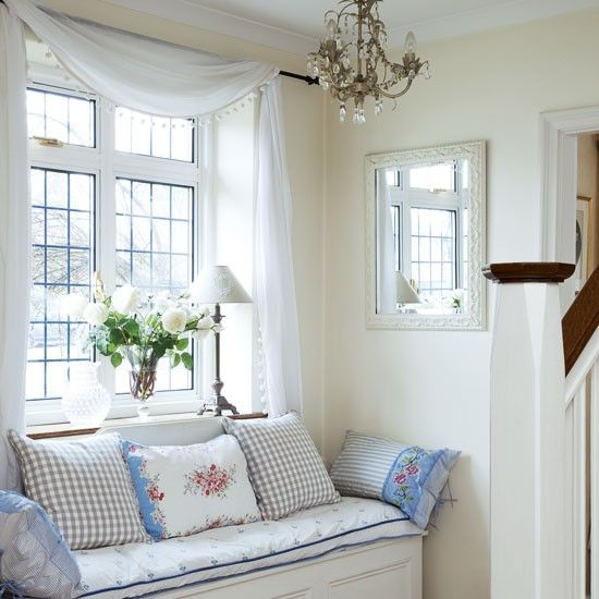 Combine storage and seating in a small hallway by tucking a storage chest  under a window