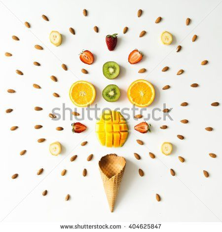 Creative layout of fresh fruits, nuts and ice cream cone. Flat lay. Summer concept. - stock photo