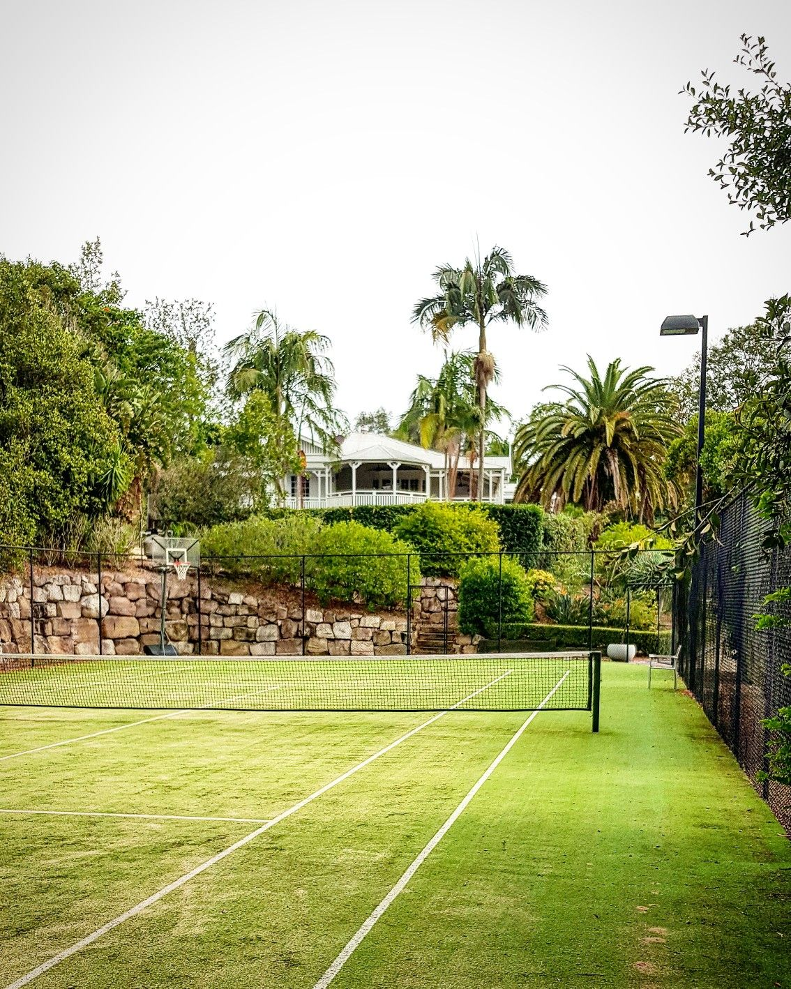 Tennis court with traditional home | Tennis court backyard ...