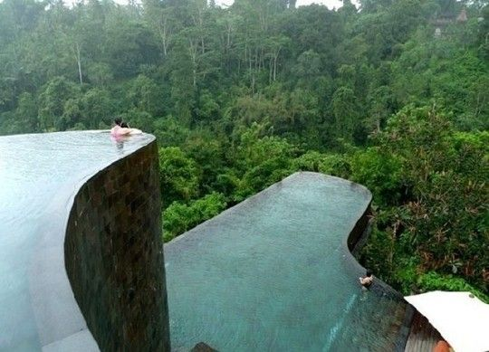 The infinity pool at the Ubud Hanging Gardens, in Bali, is two stories tall and overlooks the surrounding rain forest. As if that weren't enough, each room also has its own plunge pool. Image from Freshome.
