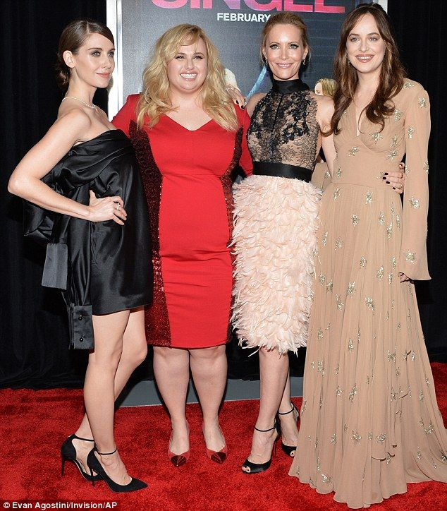 At last: Alison, Rebel and Leslie looked relieved when co-star Dakota Johnson arrived to p...