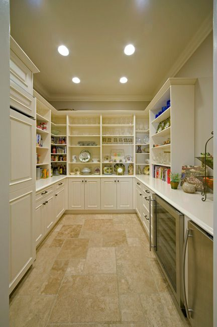 What a walk-in pantry! Wish I had this house Pinterest Pantry