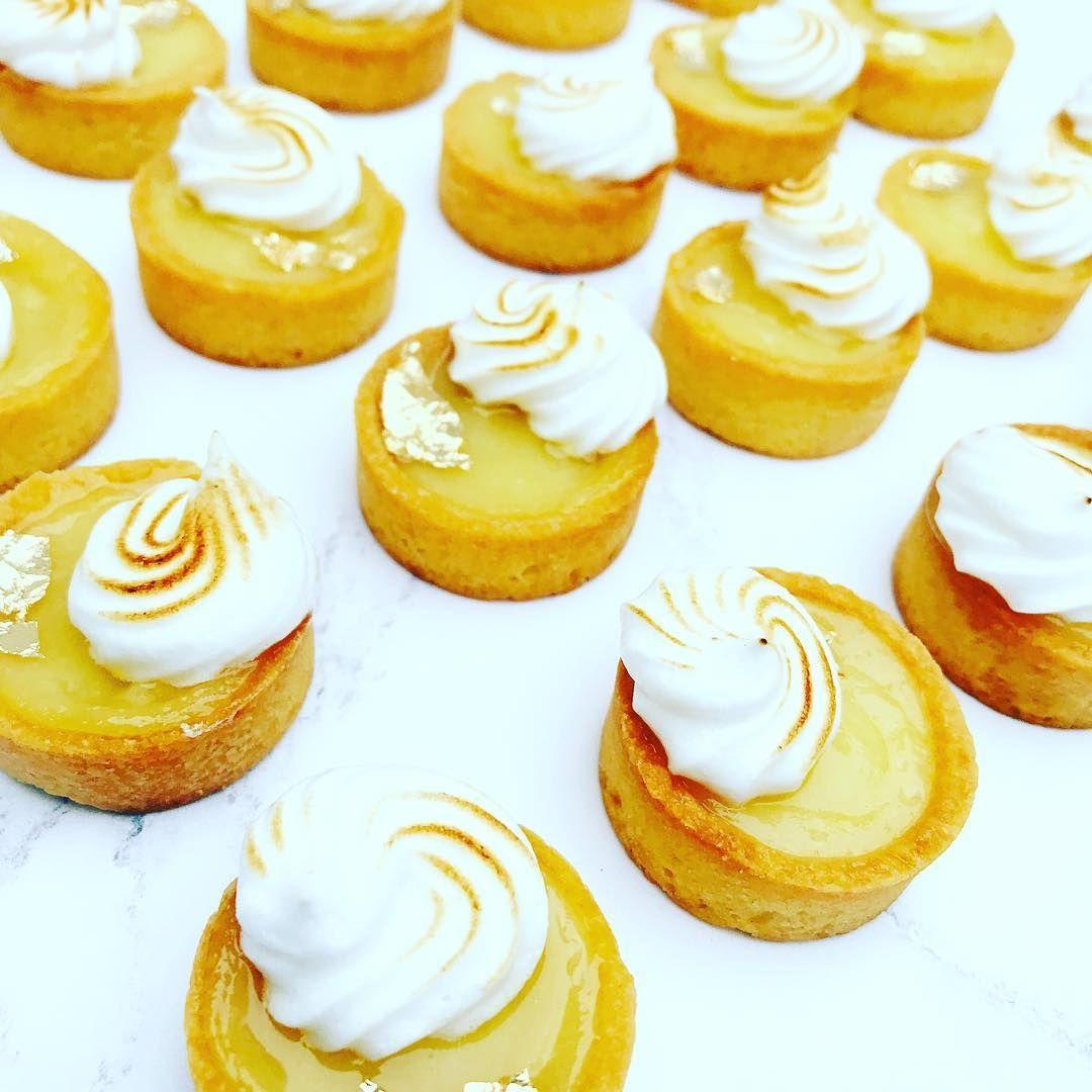 Lemon meringue tarts baking dessert table lemon