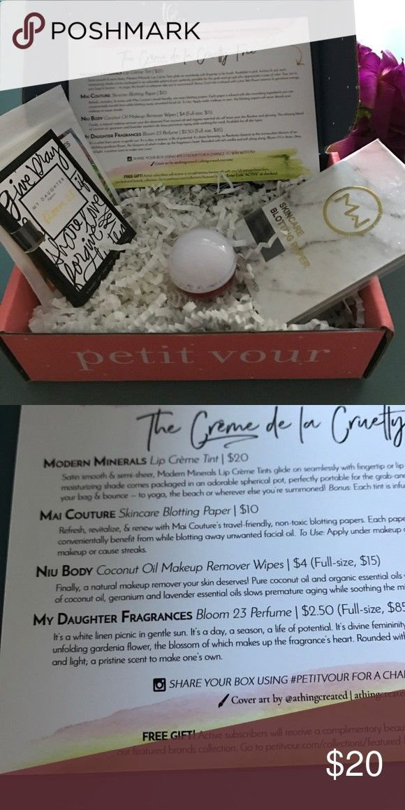 petit vour box Lip creme tint, Skincare blotting paper, sample coconut oil makeup remover, sample Bloom. 23 perfume Makeup
