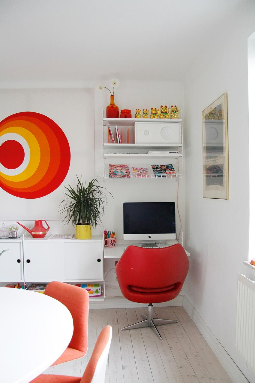 Colourful mini workspace in the family home - love the reds and yellows against the white walls