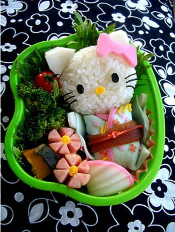 Hello Kitty bento box. Ingredients: (Rice, Fish cake, Hot dogs, Broccoli, Bacon strip, Carrot, Egg)