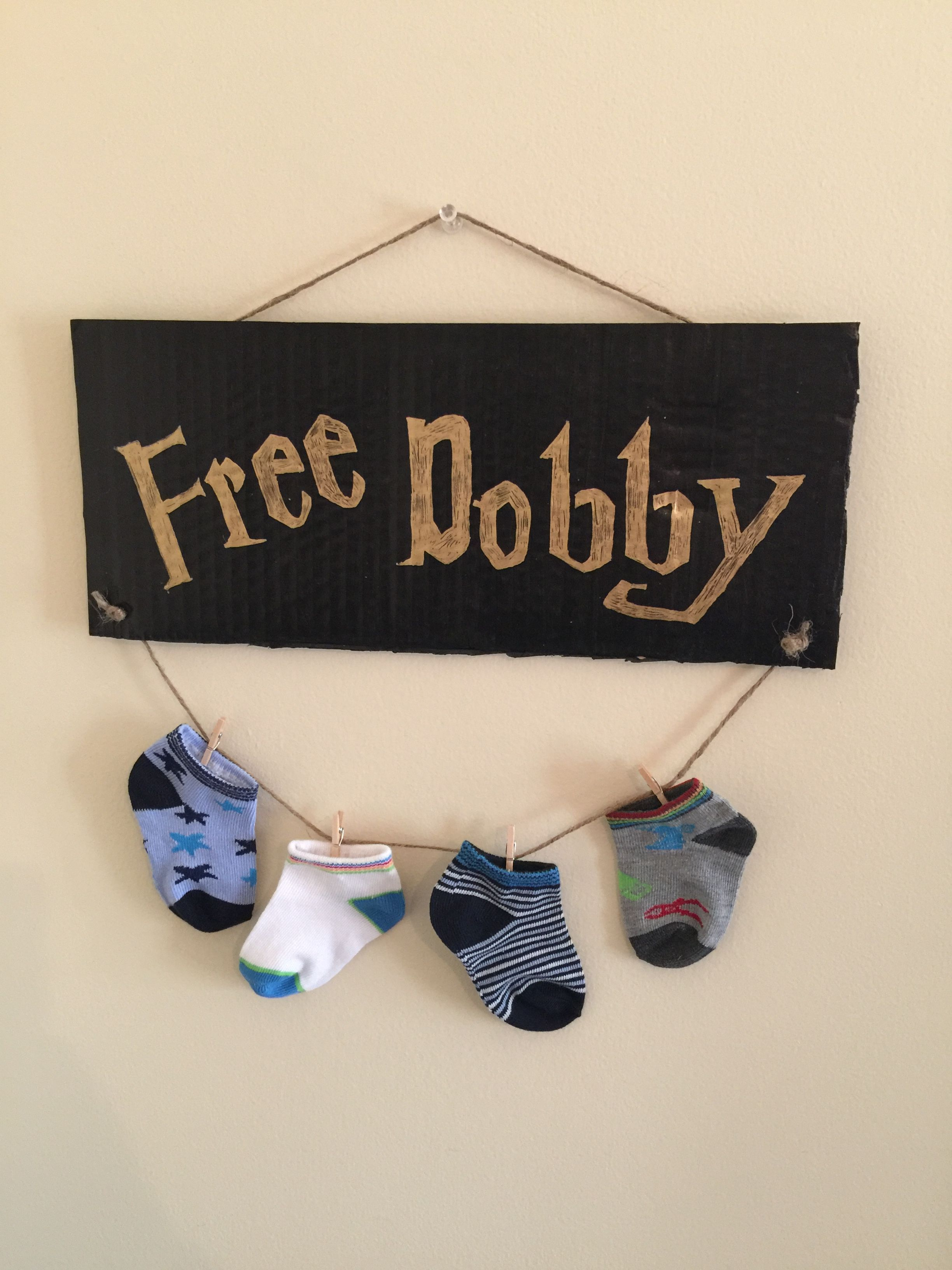 FREE DOBBY Harry Potter DIY simple as a piece of card board black & gold paint! Some twine and baby socks! ❤️