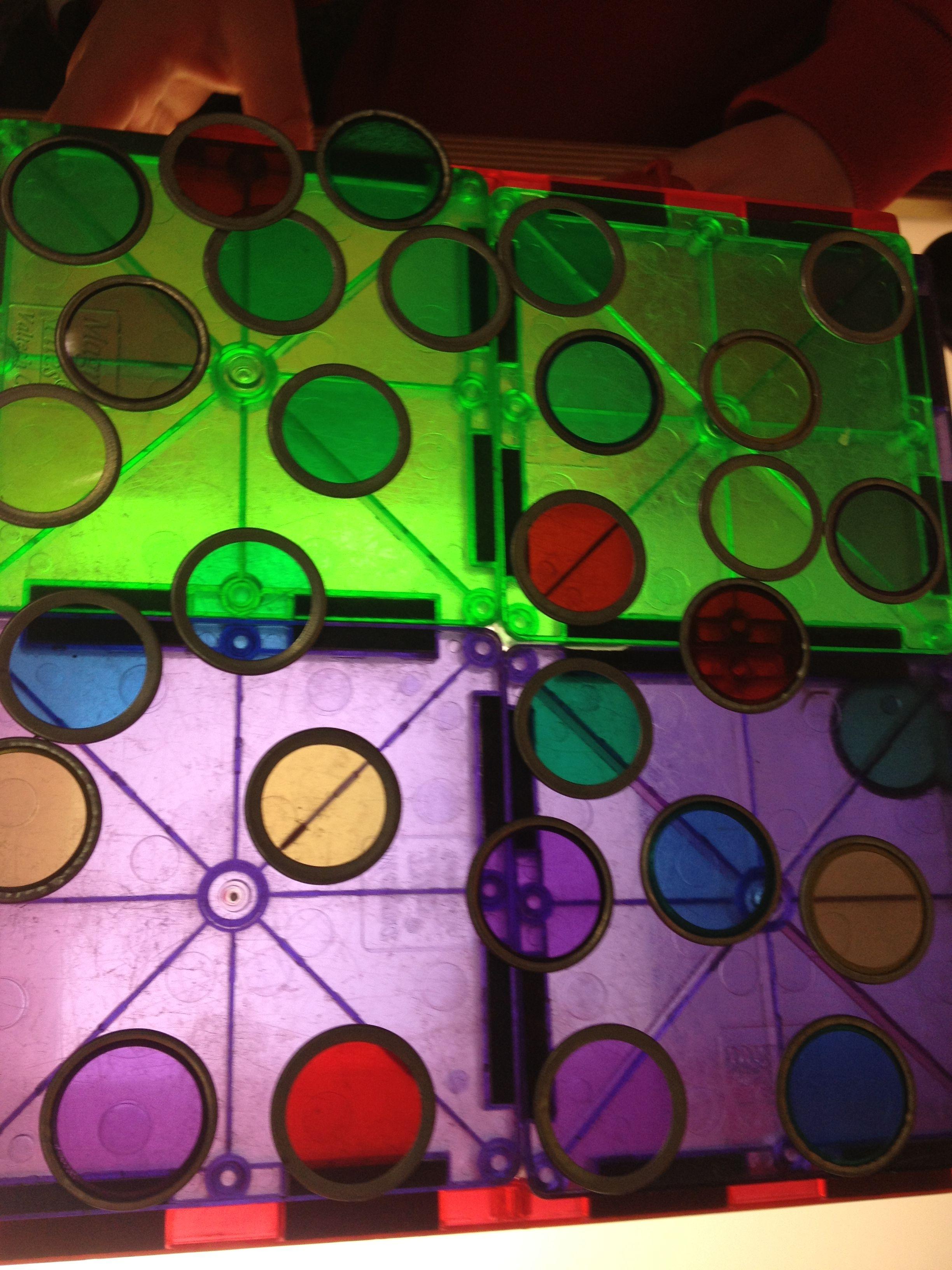 Magnetic bingo chips on magna-tiles on light table
