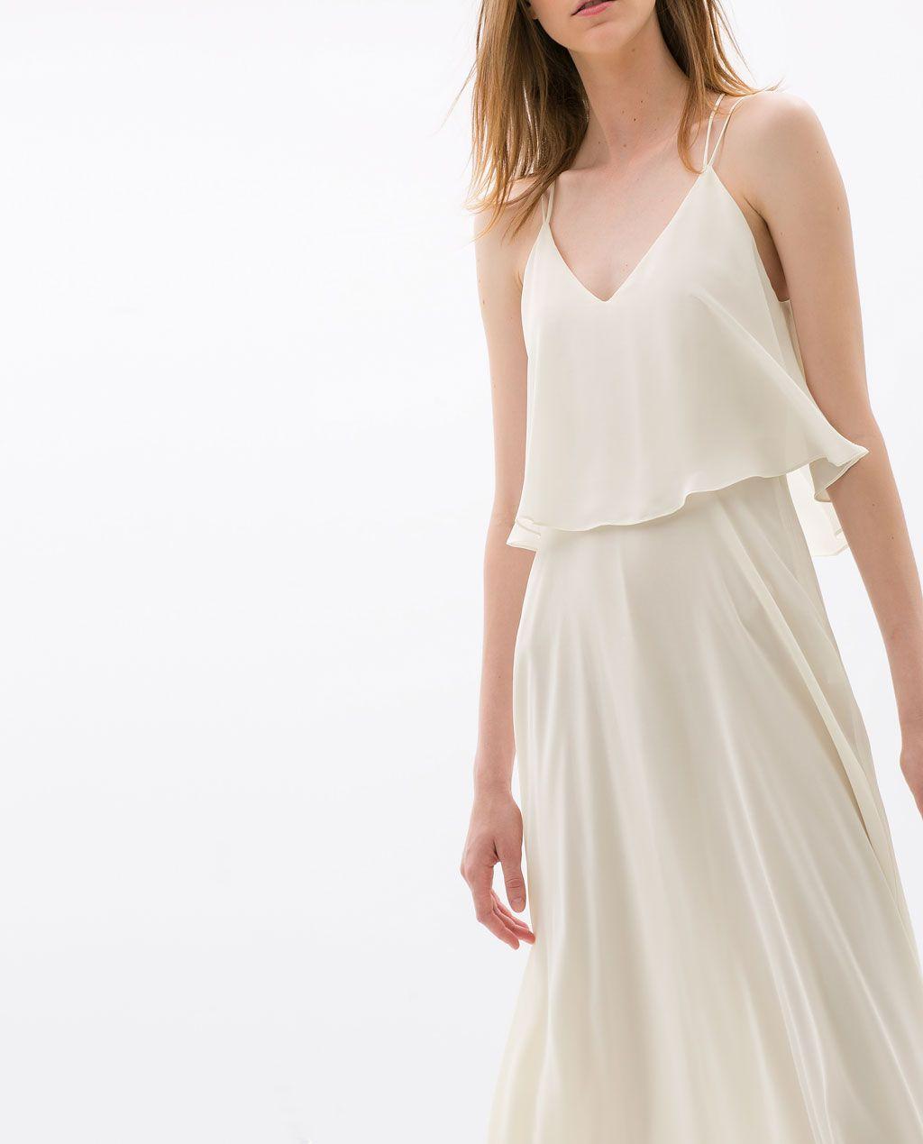 I love this flowing cream dress from Zara. Beautiful