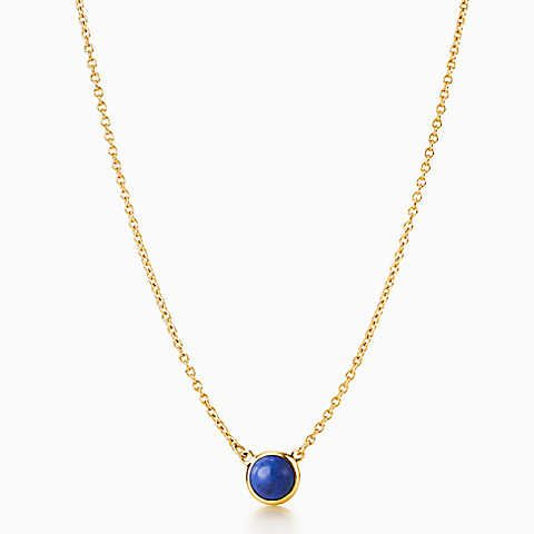 Elsa Peretti® Color by the Yard pendant in 18k gold with lapis lazuli.