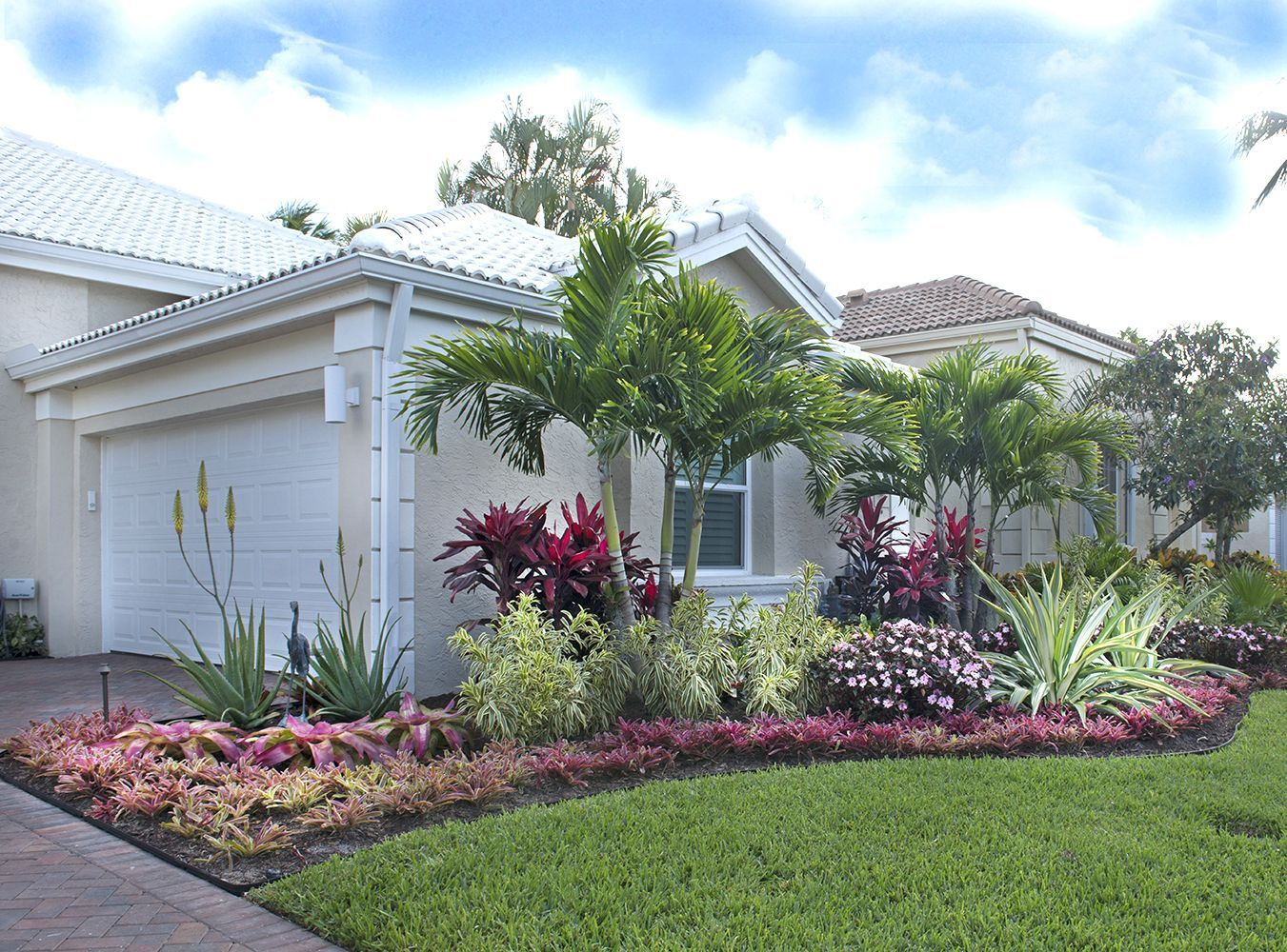 Colorful bromeliads and agaves adorn this lovely Palm Beach Gardens ...