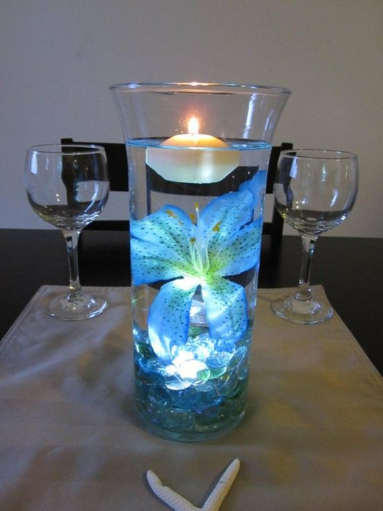 waterproof led under rocks floating candle centerpiece ideas