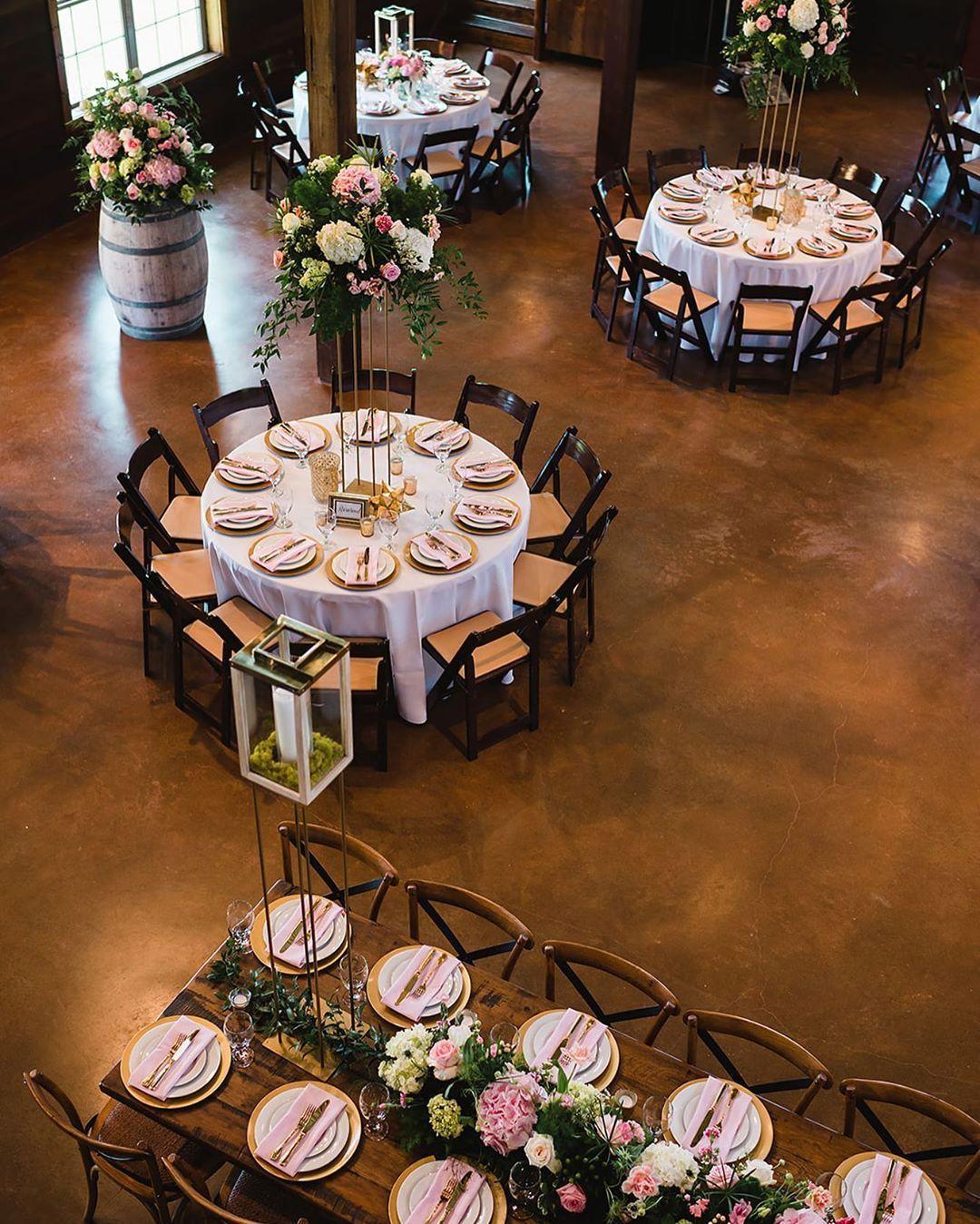Summer wedding reception with pink fine art florals at