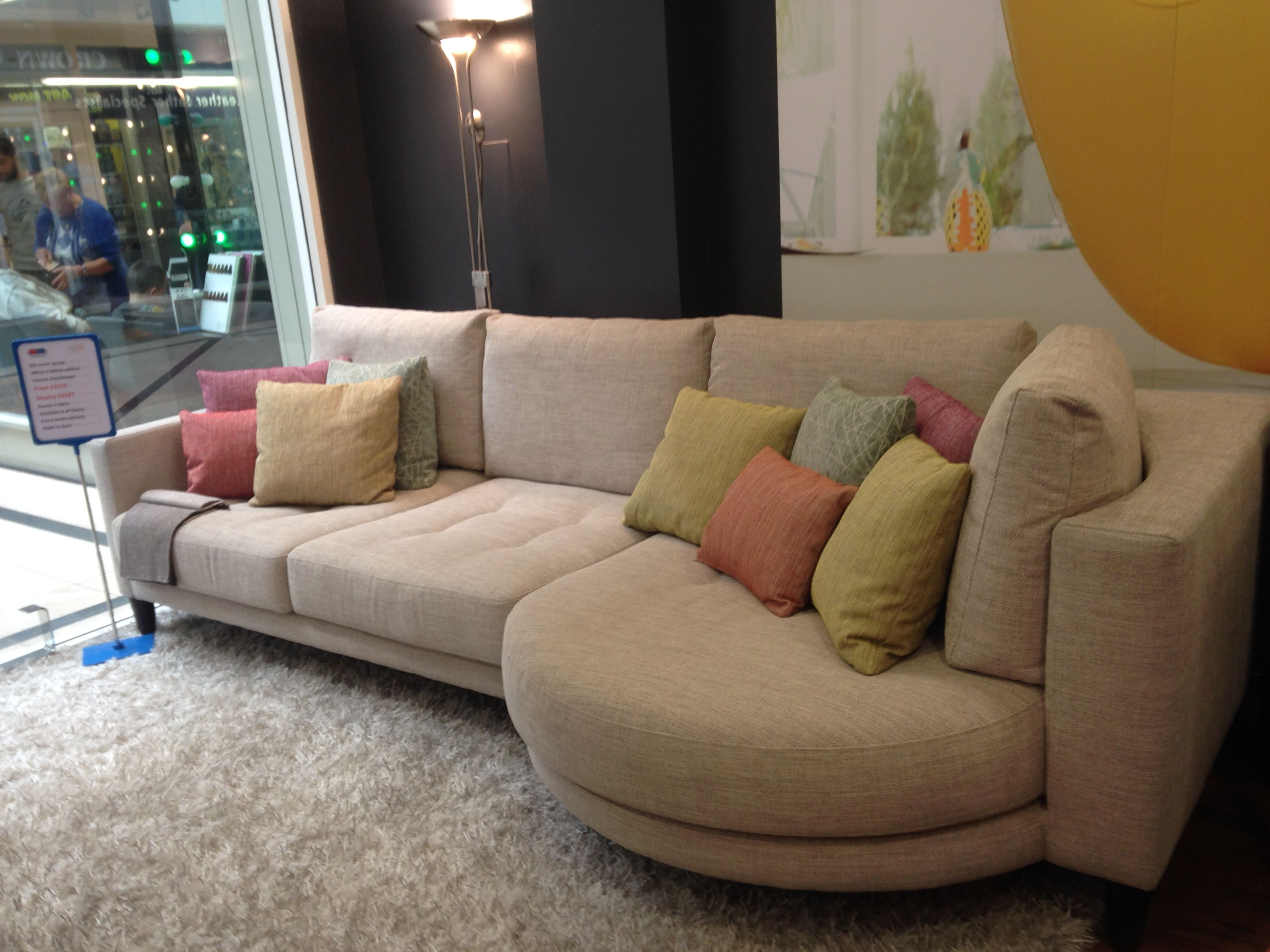 Deep High Backed Cream Fabric Sofa And Rounded Chaise Measuring 308 Cm Wide X