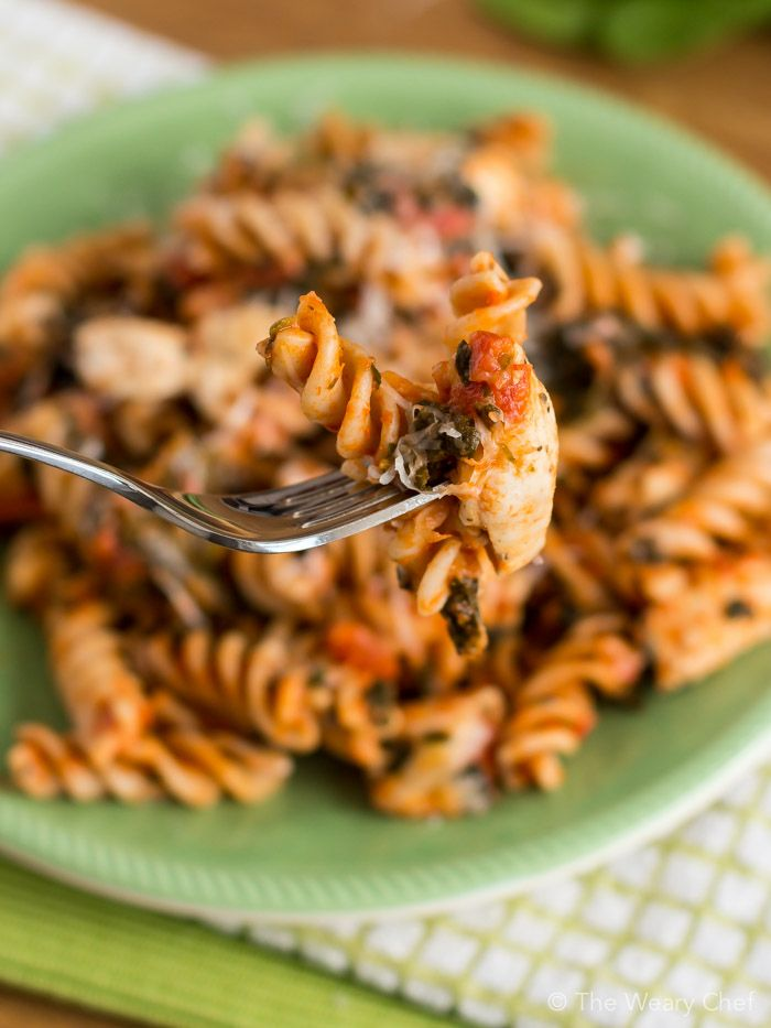 Easy Chicken with Pasta Dinner Recipe - Dress up your spaghetti with chicken, spinach, and a bit of spice!