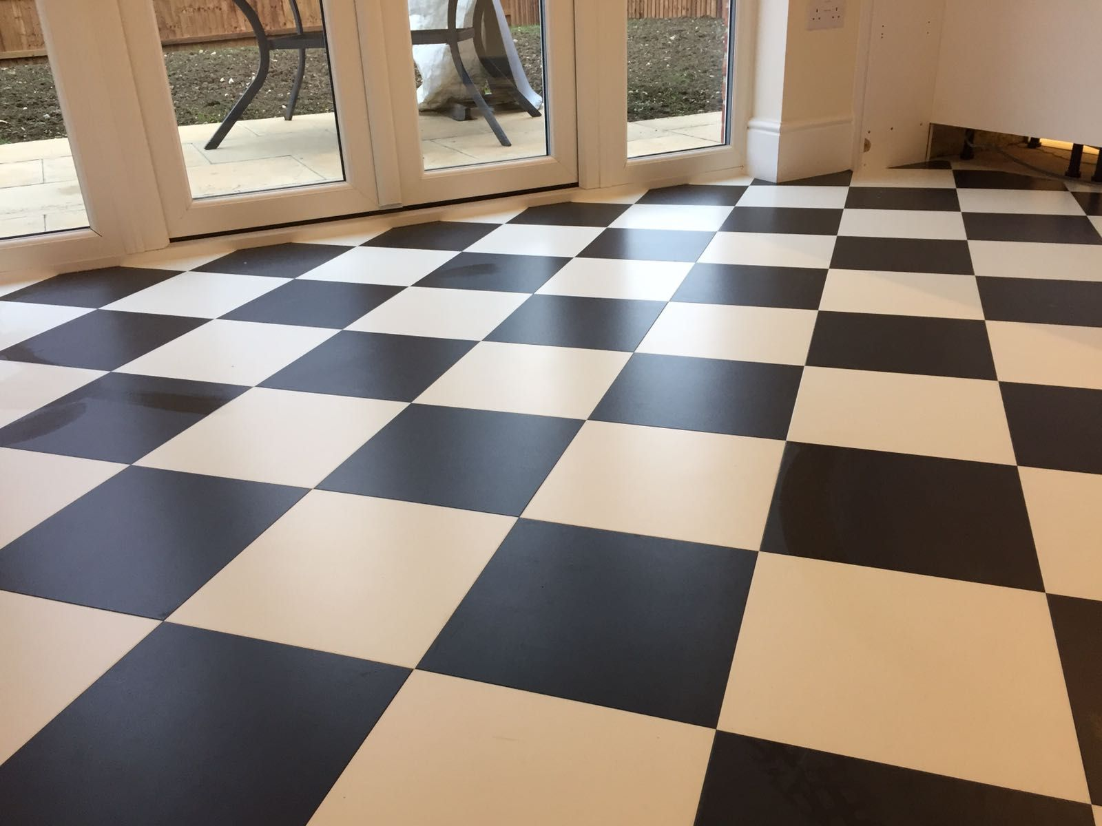 A checkered chess board tile style floor that we fitted in leicester a checkered chess board tile style floor that we fitted in leicester michael dailygadgetfo Images