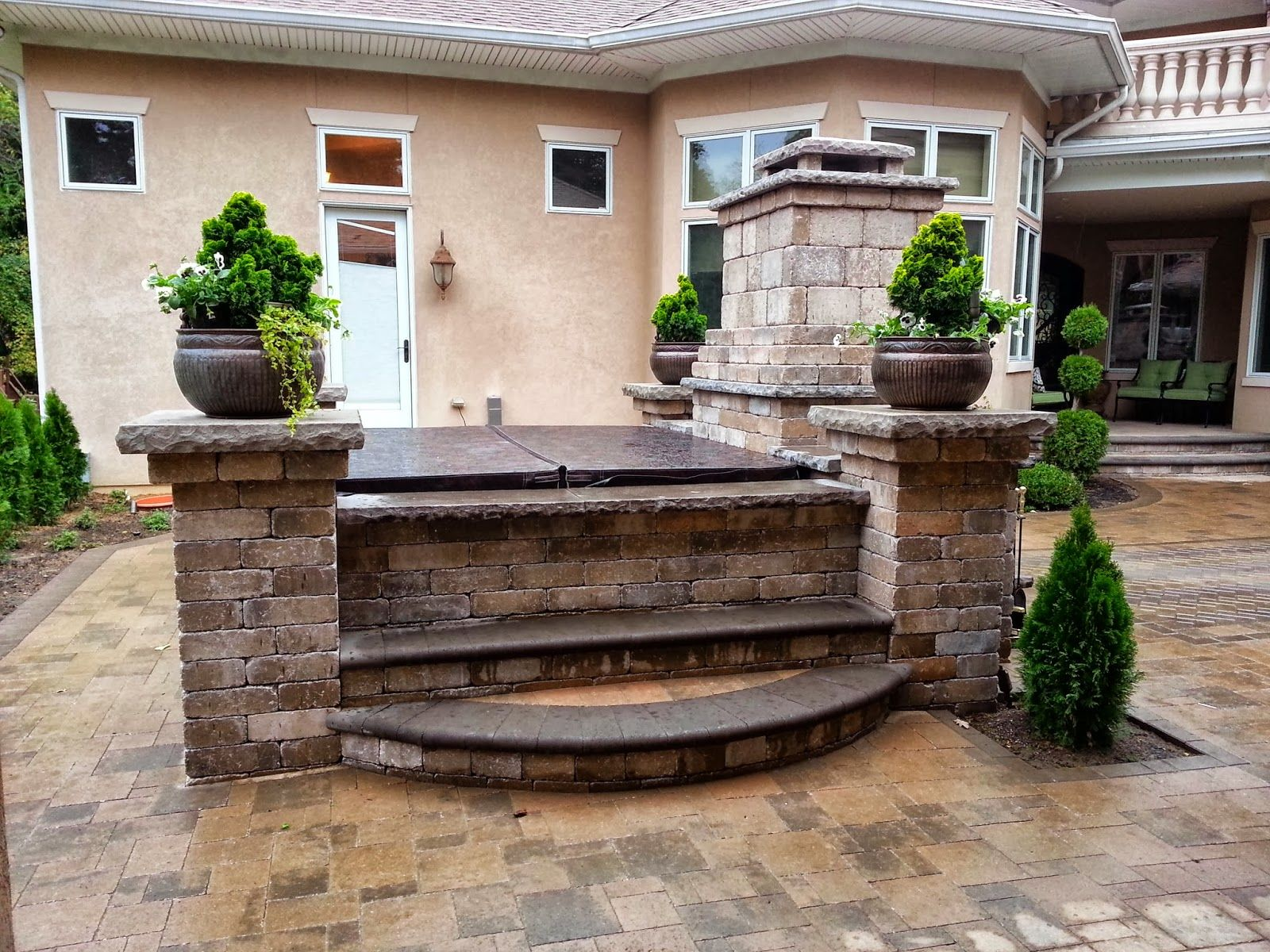 Patio paver photos with hot tubs fireplace hot tub for Spa patio designs