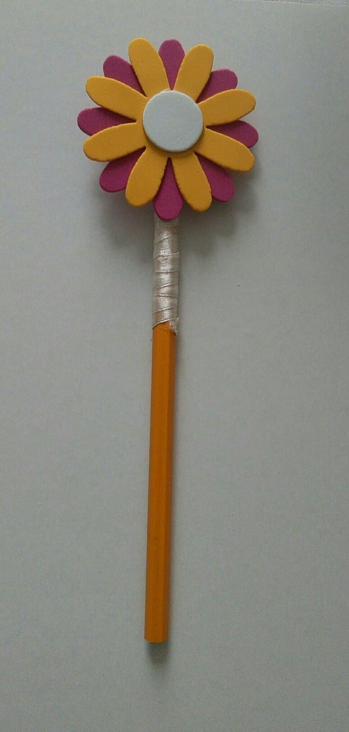 matita rivestita con nastro,fiore realizzato con gomma crepla.per info contattatemi via email rdlmcl@ hot mail .it