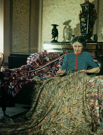 Madge Gill, artist and spiritualist, at work in London. Getty Images.