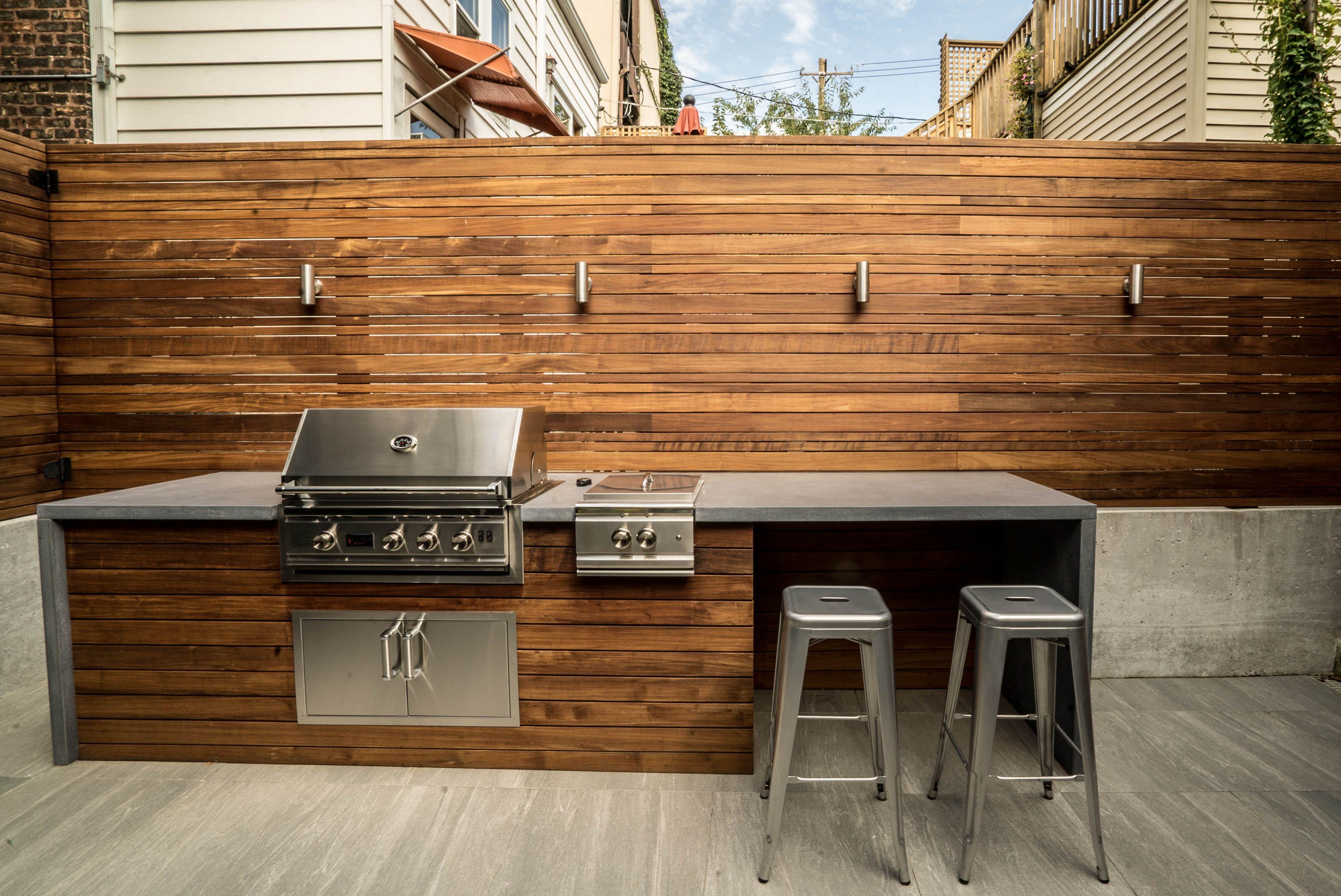 Ipe fence custom fence concrete retaining wall outdoor