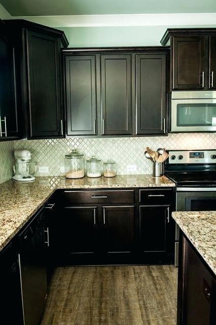 dark cabinets with granite arabesque tile with espresso ...