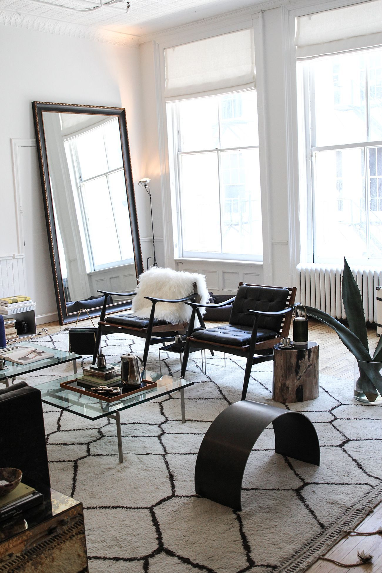 That Mirror In The Back Is Definitely Catching My Eye. Placing Large Mirrors  By Your Windows Can Help Open Up And Brighten Your Space!