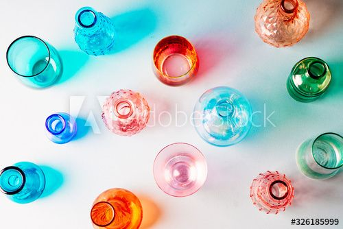 Overhead shot of various colored glasses brightly lit showing reflections and shadows #Ad , #AFFILIATE, #colored, #glasses, #Overhead, #shot, #brightly