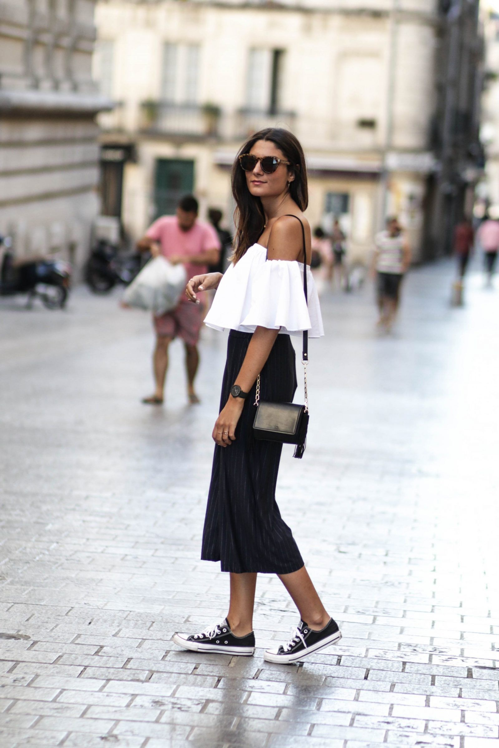 Classic black converse are the ideal match to an outfit consisting of  culottes and an off the shoulder top 6785a3a19