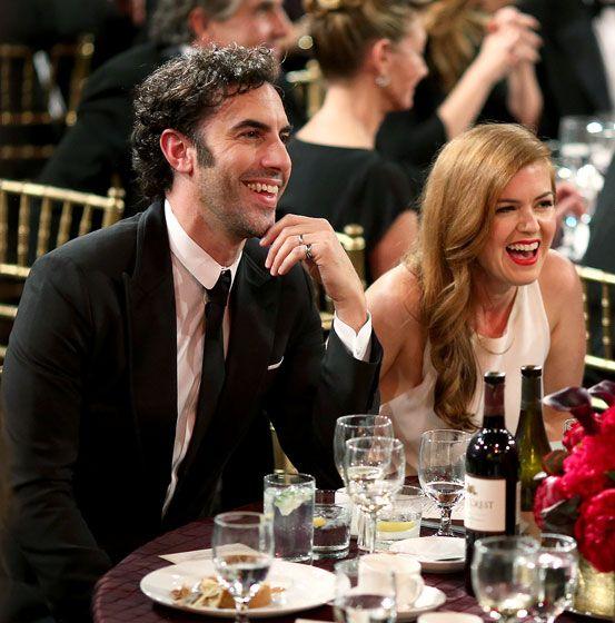 Sacha Baron Cohen and wife Isla Fisher guffawed at the 2013 BAFTA L.A. Jaguar Brittania Awards.