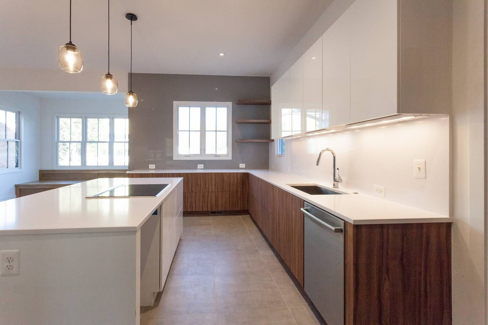 Modern Kitchen With White High Gloss And Striated Wood Cabinets In Custom Contemporary Home By Bcn Homes In Ar Modern Kitchen Contemporary House Custom Kitchen