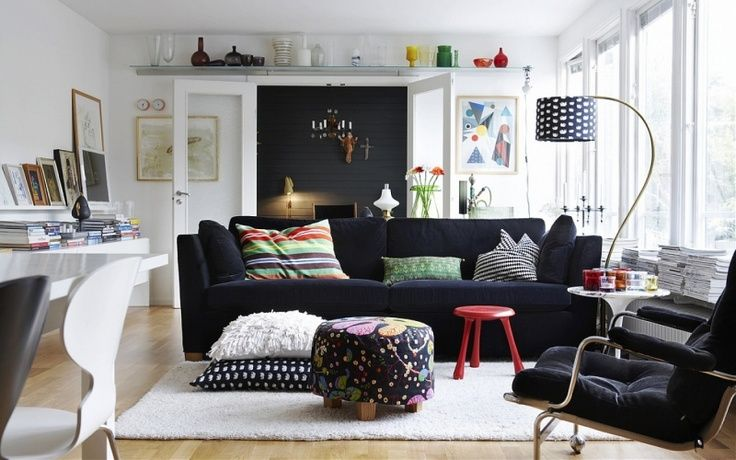 Black Ikea Stockholm Sofa With The Velvet Sandbacka Cover, Along With A  Floor Lamp Covered