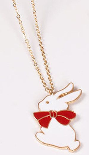 An adorable necklace with a charm of a cuddly white bunny and his big red bow. Comes with an adjustable gold coloured chain.