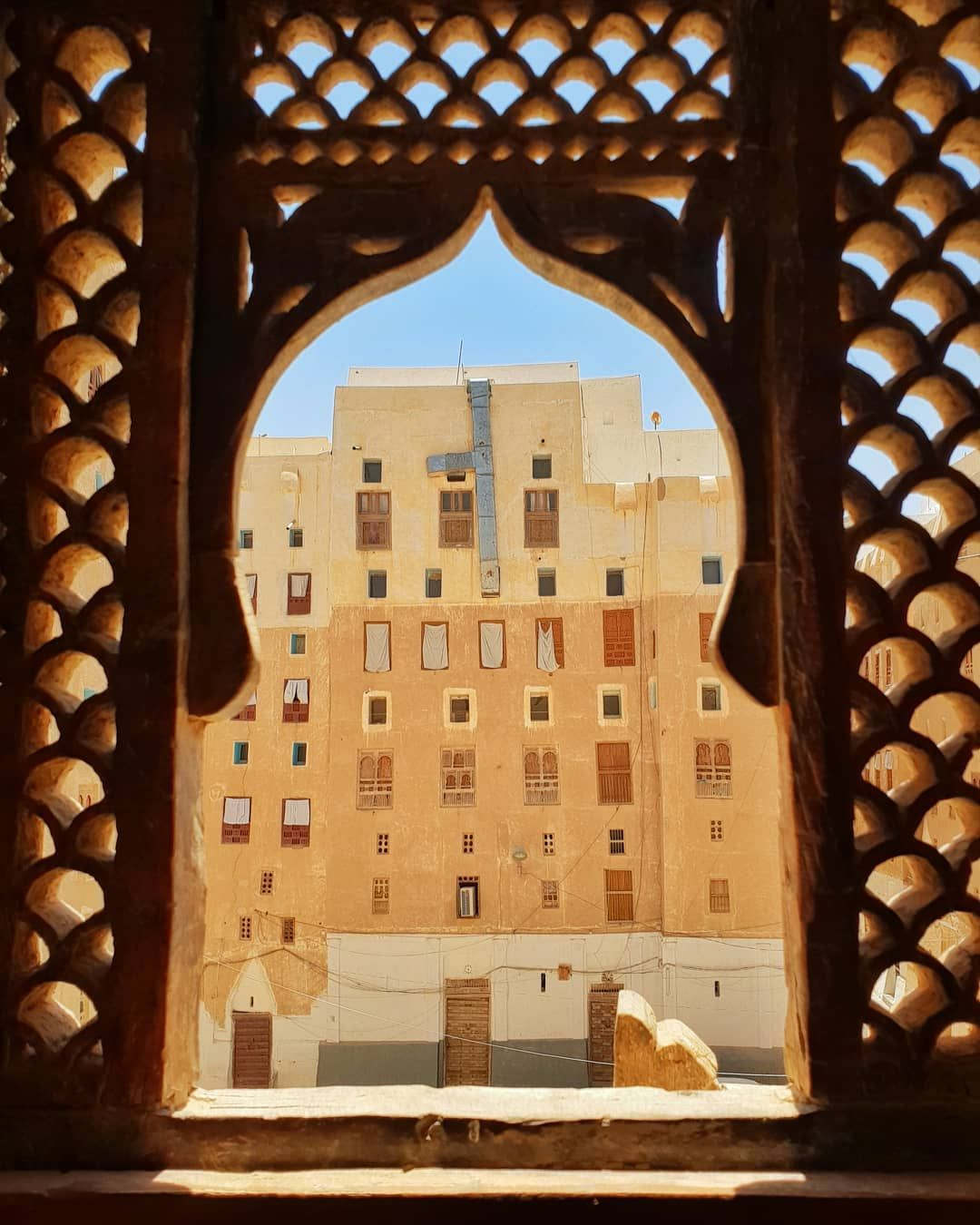 Wooden decorated window in shibam old city unesco world heritage site in yemen