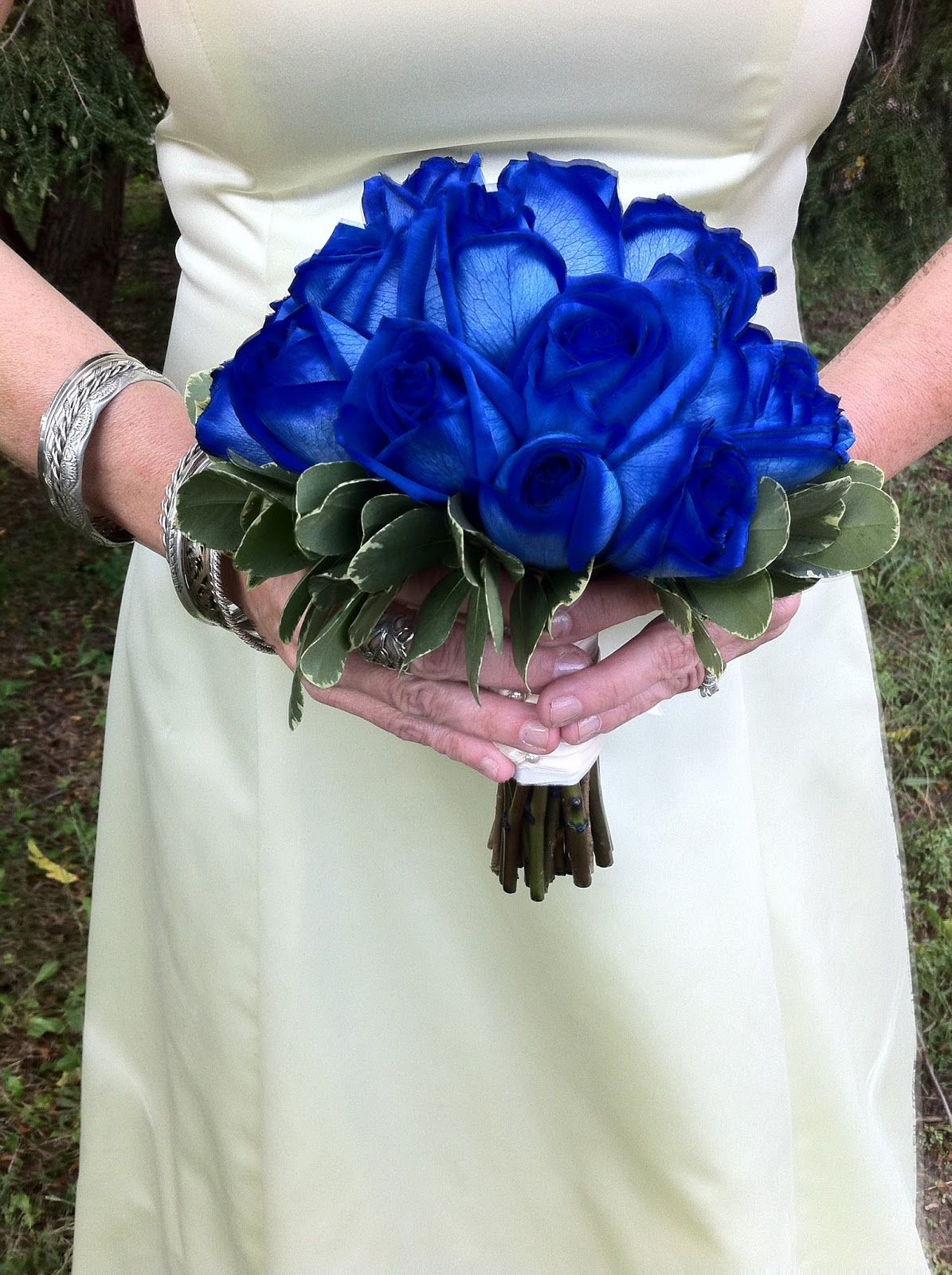 Stunning bridal bouquet arranged with blue roses green foliage stunning bridal bouquet arranged with blue roses green foliage izmirmasajfo