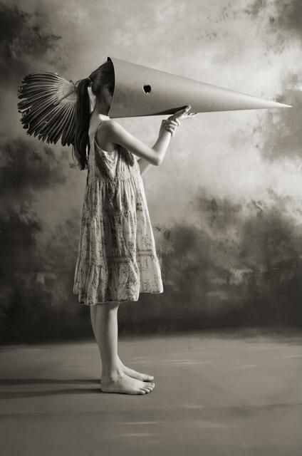 she practices with the paper cone, training her eyes to look east and west, up and down at once.
