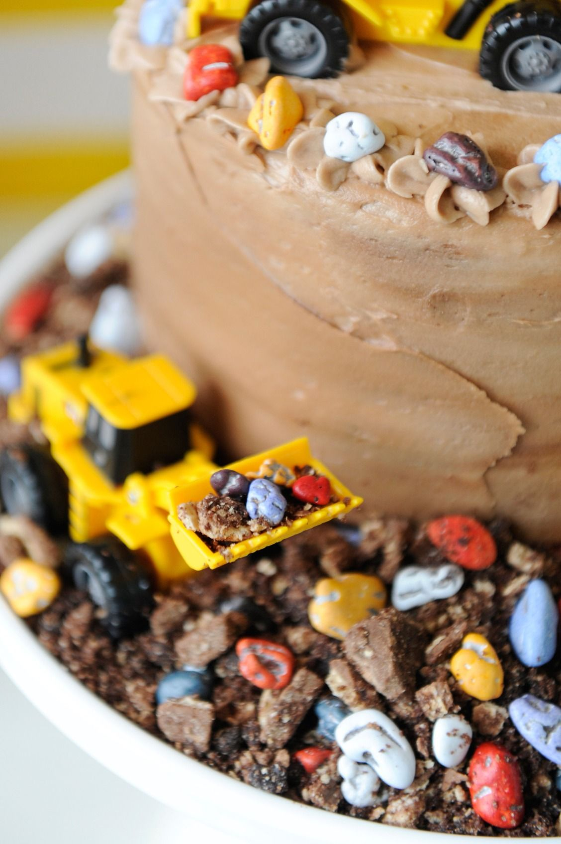 Toy truck birthday cake surrounded by rock candy and