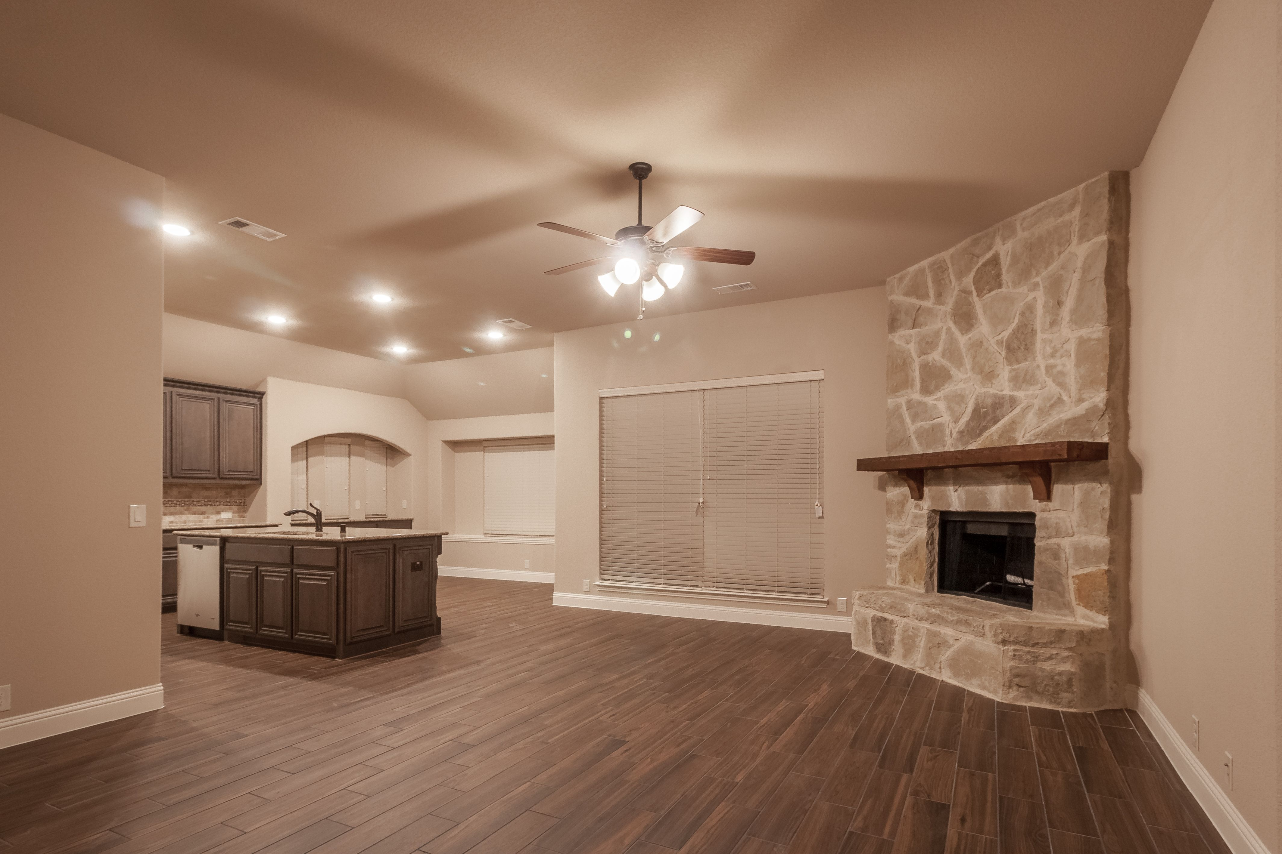 Wood Flooring, stone to ceiling fireplace fireplace